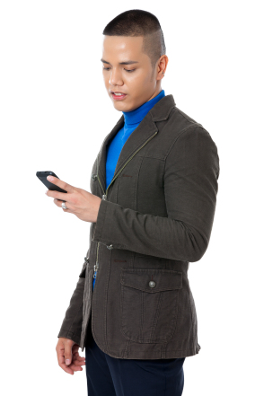 Portrait of a young businessman reading a text message against the white background